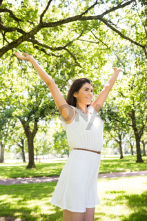 Cheerful woman with arms raised
