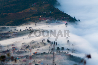 Layer of Mist Over the Mountains and in a village