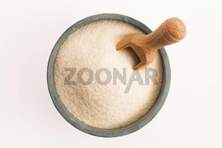 Bowl of semolina isolated on white