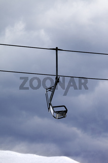 Chair lift at gray windy day