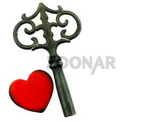 Old metal key and red heart.