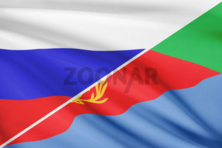Flags of Russia and State of Eritrea blowing in the wind. Part of a series.