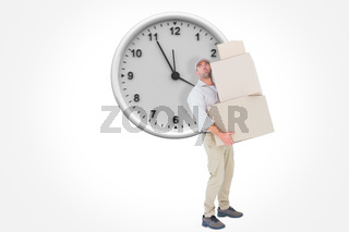 Composite image of tired delivery man carrying stack boxes