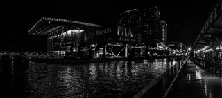 Black white night panoramic view on Bimhuis Jazz Hall IJharbour in Amsterdam