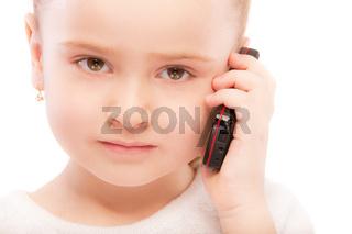 Portrait of beautiful preschool child with phone