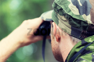 close up of soldier or hunter with binocular