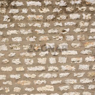 Mauer mit breiten Fugen als Hintergrund