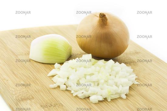 Raw onion, chopped on a wooden board