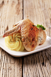 Roasted chicken wing and mashed potato