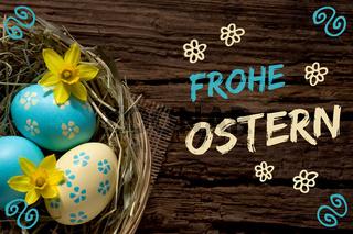 Osternest auf altem Holz mit dem Schriftzug Frohe Ostern