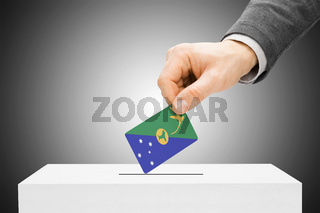 Voting concept - Male inserting flag into ballot box - Christmas Island