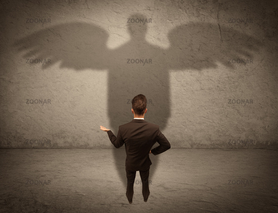 Honest salesman with angel shadow concept