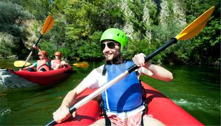 canoeing man river