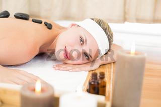 Beautiful blonde enjoying a hot stone massage