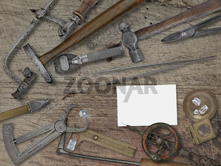 vintage jeweler tools over wooden bench