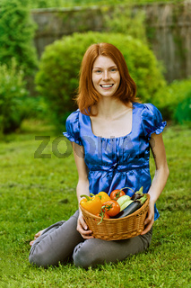 young woman with baskets of fruit and vegetables