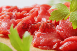 Thinly sliced raw beef meat