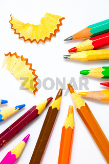 several colored pencils and shavings