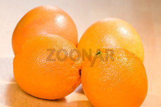 fruits two oranges and two grapefruits
