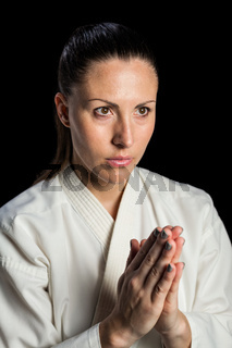 Close-up of female karate fighter meditating