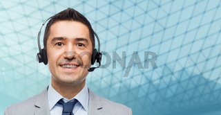 happy businessman in headset over grid background