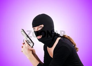 Criminal with gun against the gradient