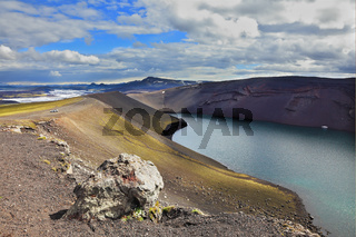 The blue lake in crater of volcano