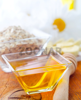 Honey in the glass bowl on the wooden table