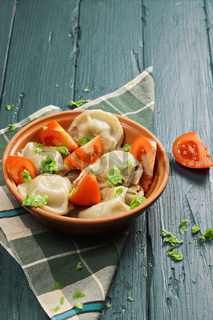 Bowl of steamed dumplings with tomato