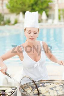 Woman cooks food