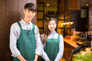 portrait waitress and waiter in cafe