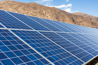 solar panels on barren mountain