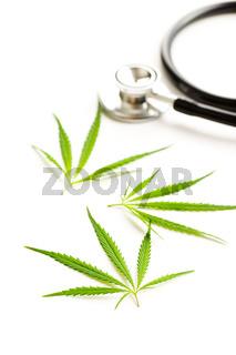 Marijuana cannabis leaves and stethoscope.