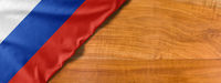 National flag of Russia on a wooden background with copy space