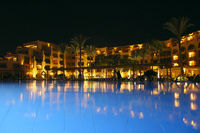 Five star hotel building with swimming pool in evening. luxurious hotel