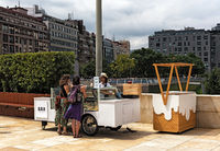 ice cream vendors and customers in the downtown area of bilbao spain