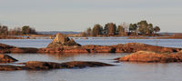 Rock formations and small island at the shore of Lake Vanern, Sweden.