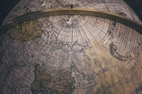 Old antique earth globe map background