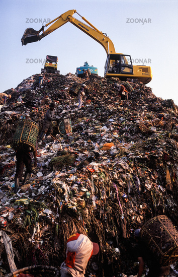 Jakarta, Indonesia, Garbage collectors search for recyclable materials at the Bantar Gebang landfill