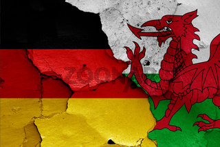 flags of Germany and Wales painted on cracked wall