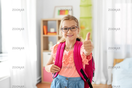 student girl with school bag showing thumbs up