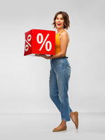 happy smiling young woman with sale sign