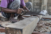 Close up of warn hands of carpenter working in traditional manual carpentry shop in a third world country.