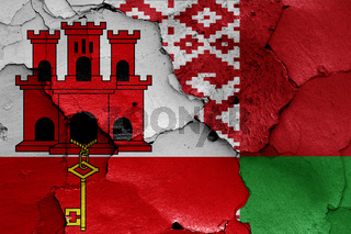 flags of Gibraltar and Belarus painted on cracked wall
