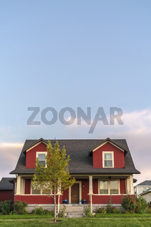 Colorful red double storey house at dusk