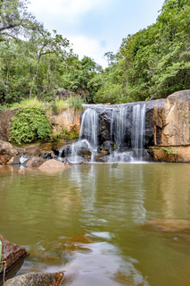 Cascade and lake in the brazilian rain forest between stones