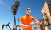 man with fitness tracker training outdoors