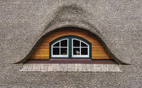 The thatched roof window