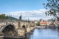Charles Bridge on the side and Prague city