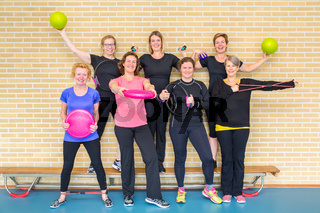 Group photo women gym class with sport equipment